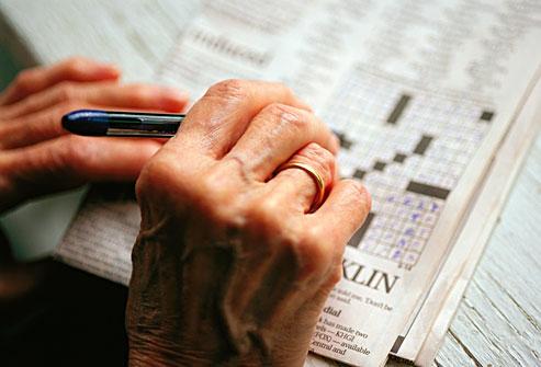 Senior woman doing a crossword